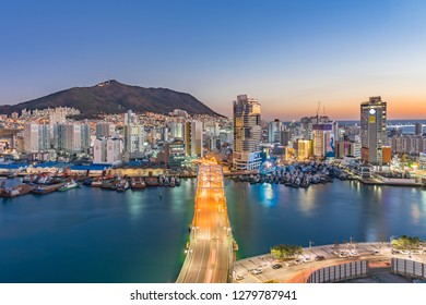 BUSAN, SOUTH KOREA - DECEMBER 29, 2018: Aerial view of Busan downtown cityscape from Lotte Department Store. Busan, formerly known as Pusan, is South Korea's second most-populous city after Seoul.