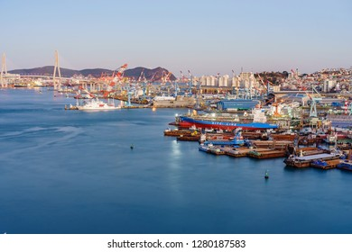 BUSAN, SOUTH KOREA - DECEMBER 29, 2018: Aerial view of Busan Harbor Bridge and the Port of Busan in South Korea. Container ship in import export and business logistic in Busan new port.