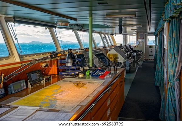 BUSAN, SOUTH KOREA - Jan 22, 2017: Wheelhouse of container ship HYUNDAI SPRINTER with various navigational equipment during stay in the port.