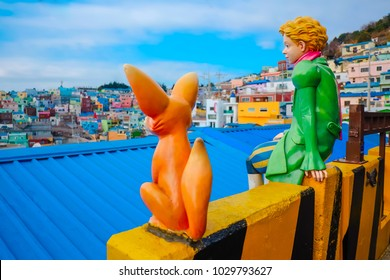 Busan, South Korea - January 2018 : Colorful statue of the boy with rabbit at Gamcheon Culture Village in Busan, South Korea.