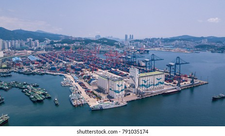 Busan, South Korea - July 2017 : Aerial view of Busan port, South Korea. Scenery consists of many boat in harbor, commercial ship, crane mountain and many building.