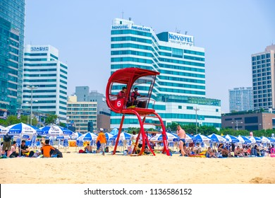 Busan, South Korea – July 2018 : Many tourists at Haeundae Beach on July 2018 in Busan, South Korea.