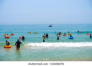 Busan, South Korea – July 2018 : Many tourists at Haeundae Beach on July 2018 in Busan, South Korea.