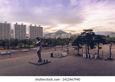 Busan, South Korea May 04, 2017: cityscape of Busan and Busan International festival sign and sculpture with beautiful skies on background