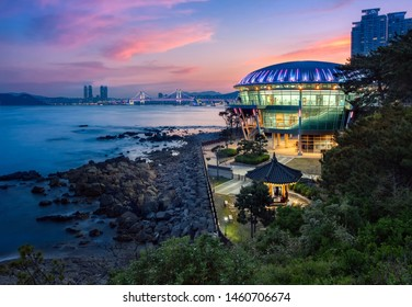 Busan / South Korea - May 22 2019: Sunset view on Daimond Bridge and APEC house from Dongbaek park.