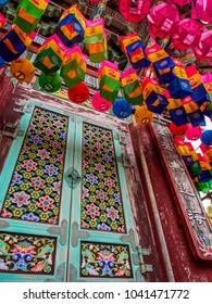 Busan, South Korea. - May 4 2014: Looking up at the Lanterns by the Floral Latticed Doors at Yonggungsa Buddhist Temple.
