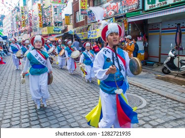 BUSAN , SOUTH KOREA - OCT 11 : Participants in the annual Jagalchi festival in Busan South Korea on October 11 2018. A traditional Sea culture and Largest seafood festival in Korea