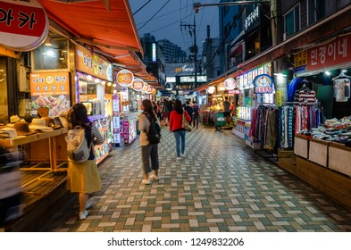 Busan, South Korea - October 16 2018: Early evening as people explore Haeundae Market in Busan, South Korea.