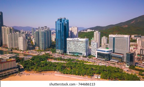 Busan, South korea - October 2017 : Aerial view of Busan city, South korea consists of high building, blue ocean, mountain and many vehicles on road. Image contains of noise, film grain and noise.