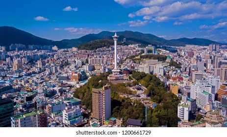 Busan, South Korea - October 2018 : Aerial view of Busan city, South Korea. Scenery consists of Busan tower, building, Busan port, bridge blue sky with clouds.