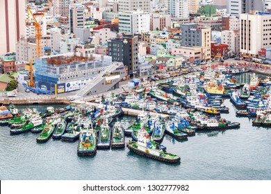 Busan, South Korea - October 7, 2017: Scenic top view of ships parked at Busan Harbor. Amazing cityscape.