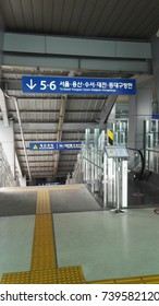Busan, South Korea  - September 9, 2017:  Exit to railway platform from departure/arrival hall of Busan Train Station. Various kinds of trains stop as well as high-speed train KTX.