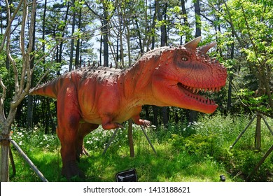 "Busan/Republic of Korea - May 24, 2019 : Animatronic Dinosaur called ""Carnotaurus"" at Songdo Sky Park in Busan, Korea. It have the realistic appearance, vivid e­xpression and lifelike movements."