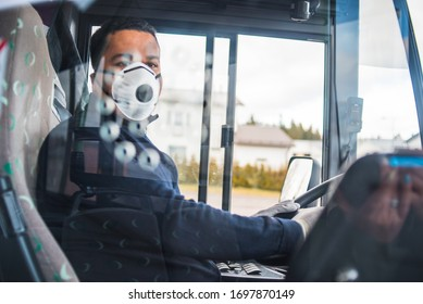 busdriver with mask puts protecting gloves on his hand in bus to protect himself from the coronavirus epidemic. Pandemic coronavirus 2020. Quarantine.Virus concept. Epidemic infection.