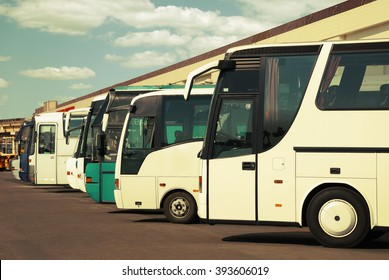 buses at the bus station with cloudy sky