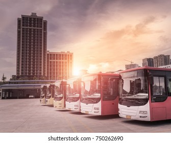 buses stop in station  during sunrise in modern city