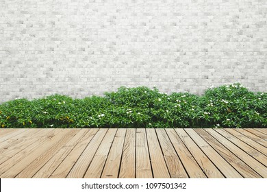 bush with brick wall and wood floor background