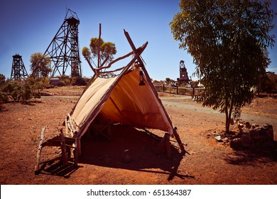 Bush camp, Tent in gold mining country. Vintage camp in front of frame head for mining.