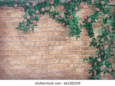 Bush climbing rose on a brick wall background,artificial flowers decor.