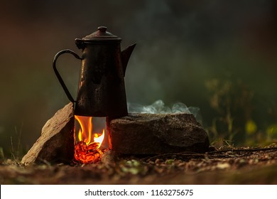 bush craft still life pot of coffee above fire