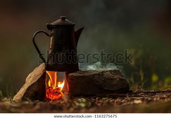 bush craft still life pot of coffee above fire