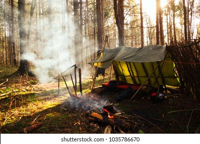 Bushcraft campsite with smoke and sunshine