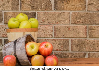 Bushel of fresh apples in a wooden bucket - straight from the Farmer's Market ready to bake pies, press fresh cider and juice, eat raw, and enjoy the sweet taste of nature.