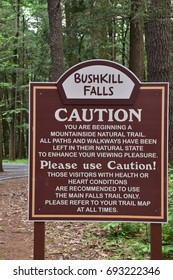 Bushkill, PA - July 27, 2017: Bushkill Falls is a park in Pennsylvania with a 100-ft waterfall plus trails, fishing, boating and other family friendly activities.
