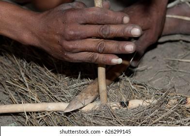 Bushman making fire in Africa