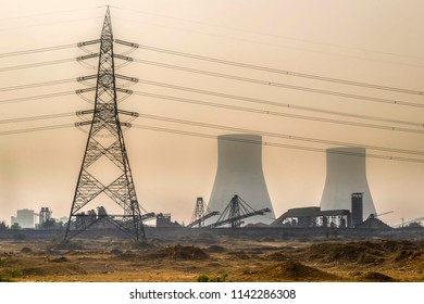Bushra, Bihar, India 12-28-2015 : Coal fired power station in Bushra near Allahabad with high voltage pole during winter smog