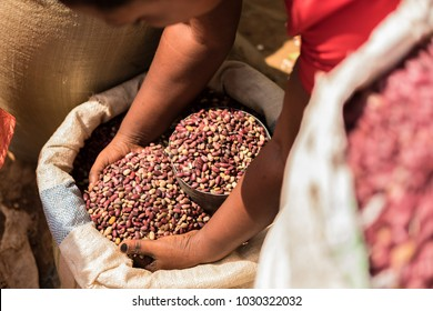 Busia market in Kenya, Africa. Hands reaching into sacks of grain and beans.