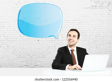 businesman sitting with notebook and blue bubbletalk