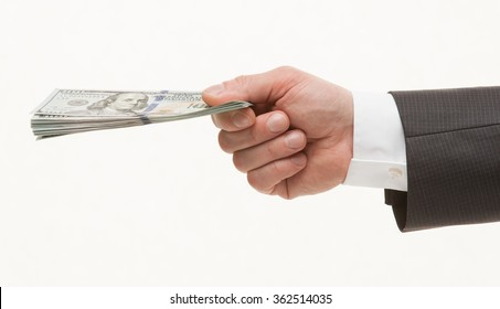 Businesman's hand holding dollars, white background