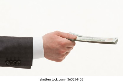 Businesman's hand holding dollars, white background
