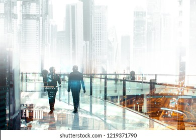 Business abstraction, two business people communicate and go on the level of the business center, double exposure
