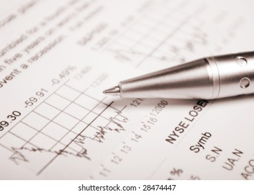 Business accessories on a background of diagrams. closeup