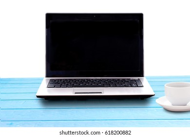 Business accessory.  Laptop for working business project on old painted blue colour wood table .