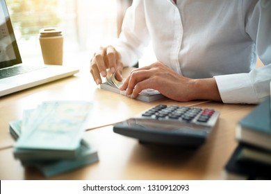 business accountant counting on banknote in office
