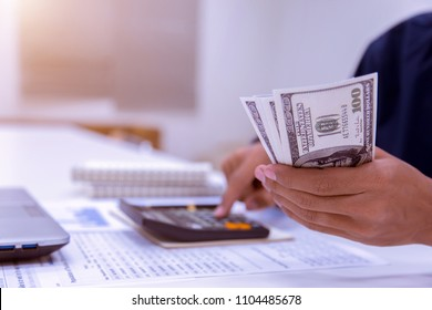 Business accountants or bankers perform savings calculations, financial accounting, business banking and economic concepts. Picture of a hand using a calculator on a desk on workplace expenses.