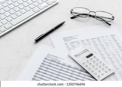 business accounter work with taxes calculation and keyboard on white office desk background