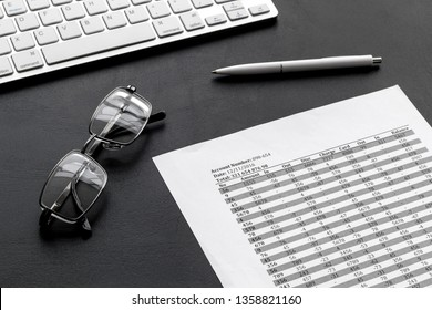 business accounter work with taxes calculation, keyboard and glasses on black office desk background