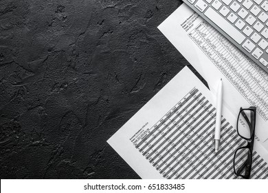 business accounter work with taxes and keyboard on black office desk top view space for text