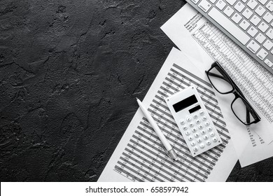 business accounter work with taxes and keyboard on black office desk top view mock up
