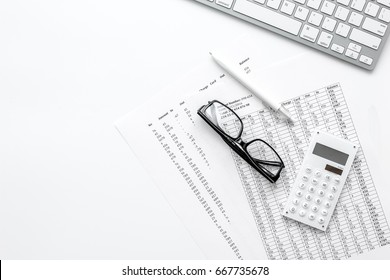 business accounter work with taxes and keyboard on white office desk top view mock up