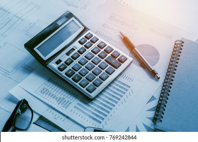 business accounting concept financial with calculator pen notbook on desk