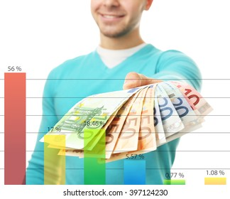 Business accounting concept. Man holding money isolated on white