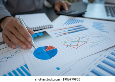 Business accounting concept, Business Man using calculator with computer laptop,pen, budget and loan paper in office.