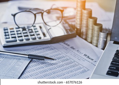 business accounting report and concept save money with pen calculator on table working area