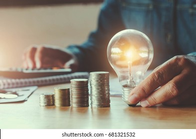 business accounting with saving money with hand holding light bulb concept financial background
