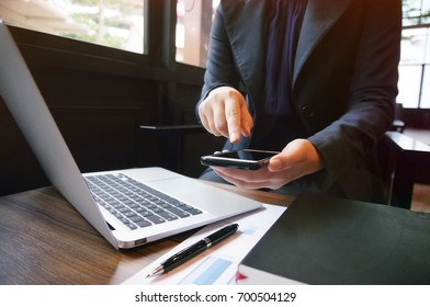Business accounting women work with smart phone. Financial technology concept.